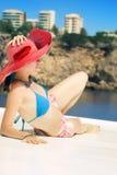 Donna con il cappello rosso Fotografia Stock