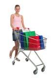 Donna con il carrello di acquisto immagini stock libere da diritti