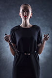 Donna con il coltello e la forcella. Immagine Stock Libera da Diritti