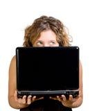 Donna con il computer portatile e le cuffie Immagine Stock