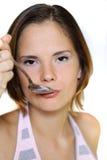 Donna con il cucchiaio Immagini Stock