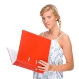 Donna con il dispositivo di piegatura Fotografia Stock Libera da Diritti