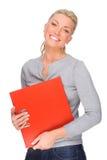 Donna con il dispositivo di piegatura Immagini Stock