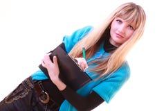 Donna con il dispositivo di piegatura e penna isolata Fotografie Stock Libere da Diritti