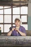 Donna con il filo Fotografia Stock
