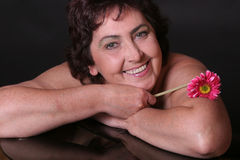 Donna con il fiore fotografia stock