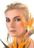 Donna con il fiore esotico Immagini Stock Libere da Diritti