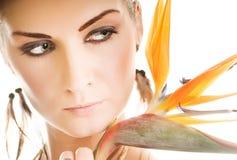 Donna con il fiore esotico Fotografia Stock Libera da Diritti