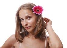 Donna con il fiore, isolato Fotografie Stock