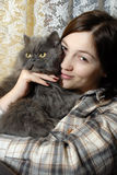 Donna con il gatto Fotografie Stock