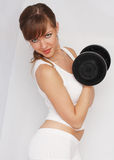 Donna con il grande dumbbell Fotografia Stock