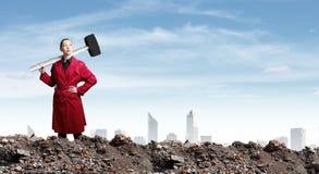 Donna con il martello Fotografia Stock