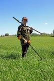 Donna con il metal detector Fotografia Stock