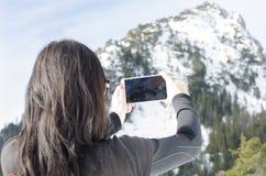 Donna con il mobile Immagine Stock
