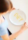 Donna con il piatto e i meds Fotografia Stock Libera da Diritti