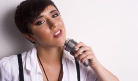 Donna con il rasoio elettrico Fotografia Stock