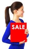 Donna con il segno di vendita Immagini Stock Libere da Diritti