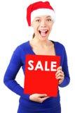 Donna con il segno di vendita di natale Fotografia Stock Libera da Diritti