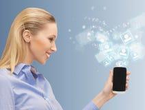 Donna con il telefono cellulare Immagini Stock Libere da Diritti