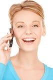 Donna con il telefono cellulare Immagine Stock