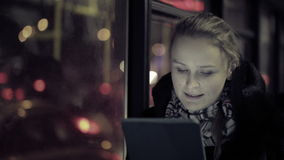 Donna con il touchpad nel bus stock footage