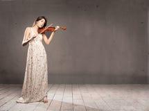 Donna con il violino Fotografie Stock