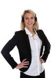 Donna con l'affare di segretario del centro di telefonata del telefono della cuffia avricolare Fotografie Stock