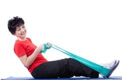 Donna con l'allungamento delle corde Fotografie Stock