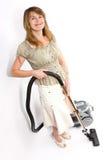 Donna con l'aspirapolvere isolato su bianco Fotografia Stock Libera da Diritti