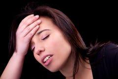Donna con l'emicrania Fotografia Stock