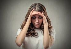 Donna con l'espressione del rammarico Fotografia Stock