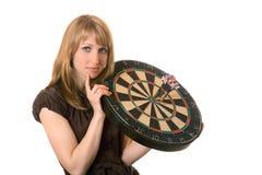 Donna con l'obiettivo del dardo sopra bianco Fotografia Stock