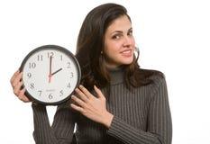 Donna con l'orologio Fotografia Stock Libera da Diritti