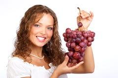 Donna con l'uva fotografia stock libera da diritti