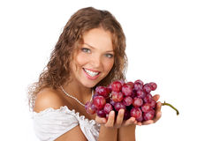 Donna con l'uva. fotografie stock