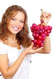 Donna con l'uva fotografia stock