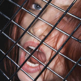Donna con la bocca aperta. Fotografie Stock