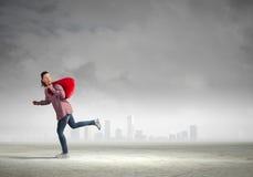 Donna con la borsa rossa Immagine Stock Libera da Diritti