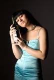 Donna con la bottiglia fotografia stock
