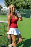 Donna con la bottiglia di acqua Fotografia Stock