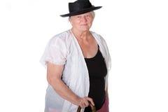 Donna con la canna ed il cappello Fotografie Stock