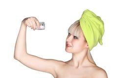 Donna con la crema di fronte Immagini Stock Libere da Diritti