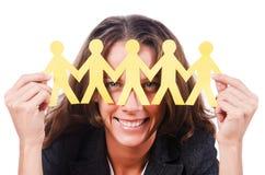 Donna con la gente di carta Fotografia Stock