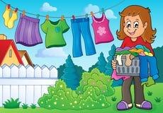 Donna con la lavanderia all'aperto Immagini Stock Libere da Diritti