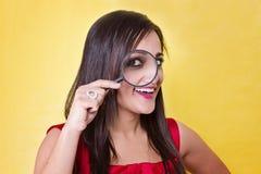 Donna con la lente d'ingrandimento Immagine Stock Libera da Diritti