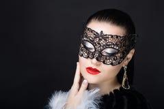 Donna con la maschera nera Fotografia Stock