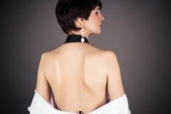 Donna con la parte posteriore nuda Fotografie Stock Libere da Diritti