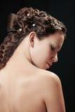 Donna con la pettinatura della treccia fotografia stock libera da diritti