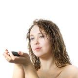 Donna con la piccola pietra Fotografie Stock