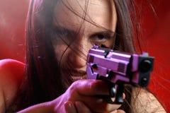 Donna con la pistola Fotografie Stock